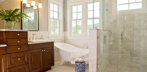 bathroom remodel and design with walk-in shower and free-standing bath tub