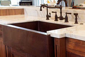 wood style farmhouse style sink in newly remodeled kitchen