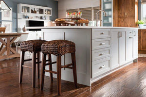 large kitchen island made of white wood cabinets