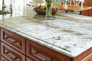 wood cabinet kitchen island with white granite countertop
