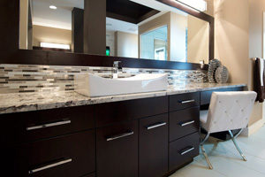 modern dark bathroom cabinet design with matching mirror and single sink