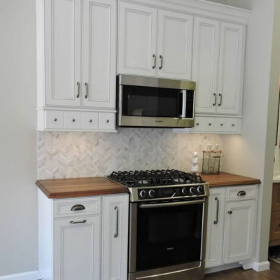 kitchen cabinet display with white cabinets