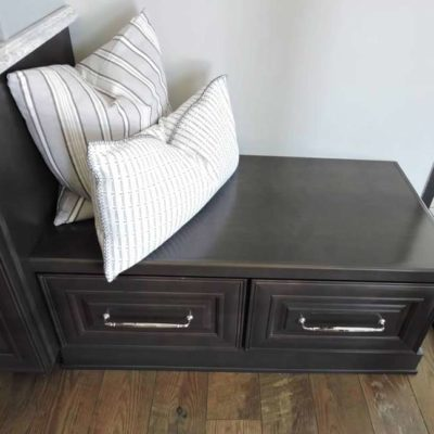 dark cabinets with pillows on top