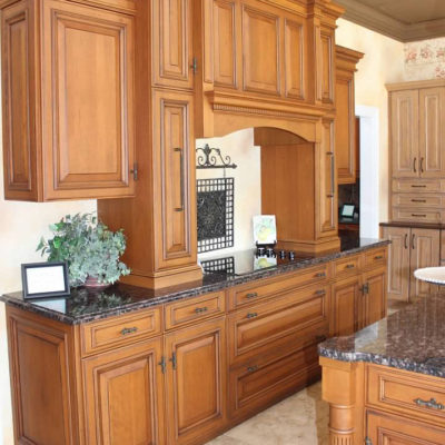 kitchen remodeling showroom with wood cabinets and granite countertops