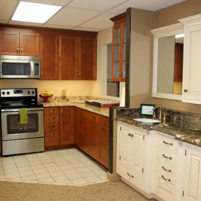 two kitchen cabinet displays side by side at christiansburg ideal cabinets showroom and design center