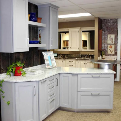 white kitchen cabinets and white countertop display at ideal cabinets