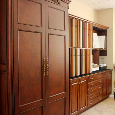 ideal cabinets showroom display featuring solid wood kitchen pantry and cabinet style and color choices
