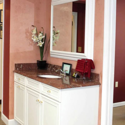 white bathroom vanity cabinets with granite countertop and white trim at ideal cabinets