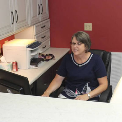 employee at ideal cabinets christiansburg store sitting behind counter