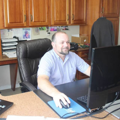 ideal cabinets kitchen and bath cabinets staff member at computer in christiansburg, va store